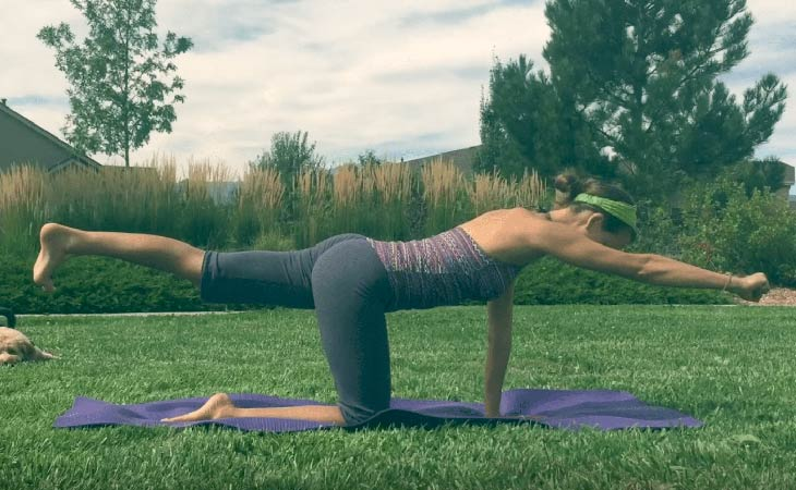 Woman Working Out Using 3-Minute Flat Belly Flow