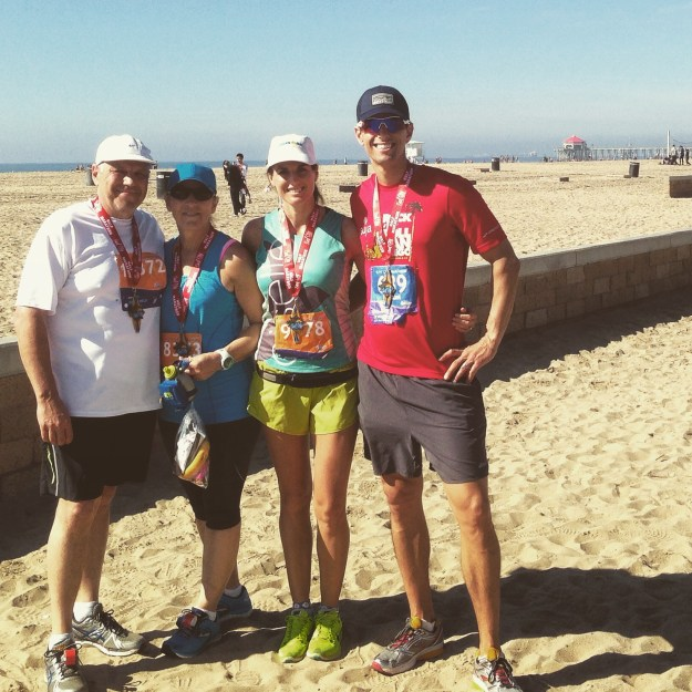 Surf City Half Marathon Finishers - we told my Dad and Step Mom the good news right before the race started!