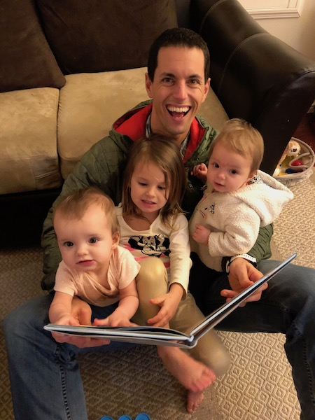 attempting to read to twin babies