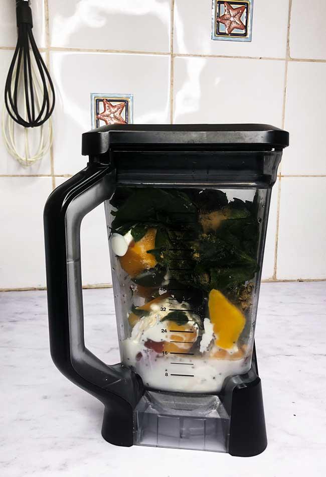 Green Smoothie Ingredients In Ninja Blender on kitchen counter