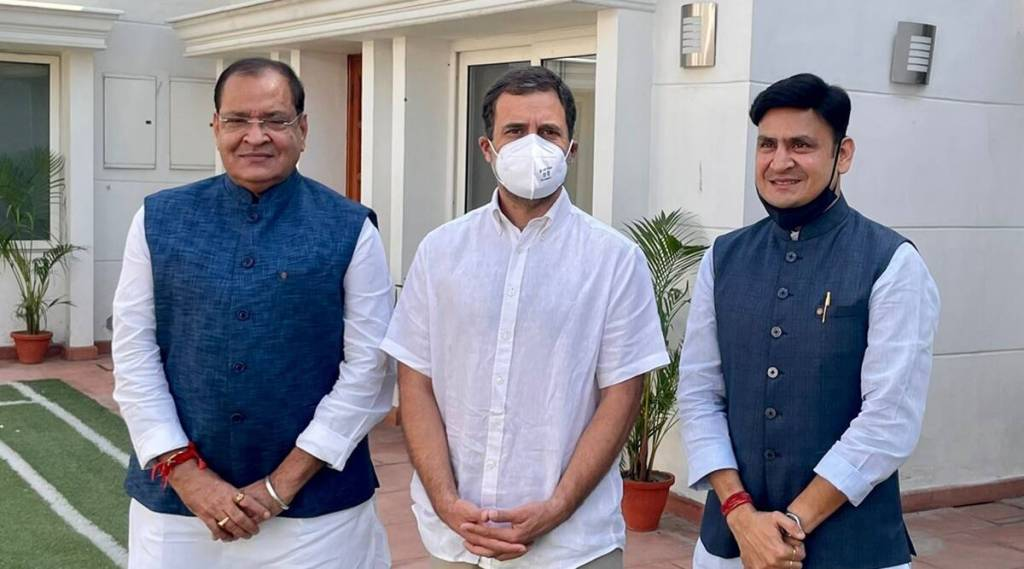 Rahul Gandhi welcomes Yashpal Arya (left) and his son Sanjeev Arya (right) to the Congress party