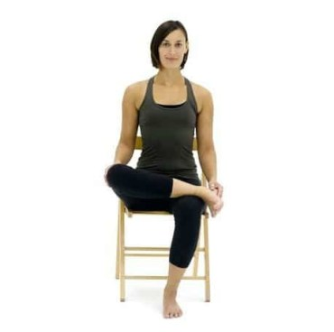 Demo of seated hip stretch