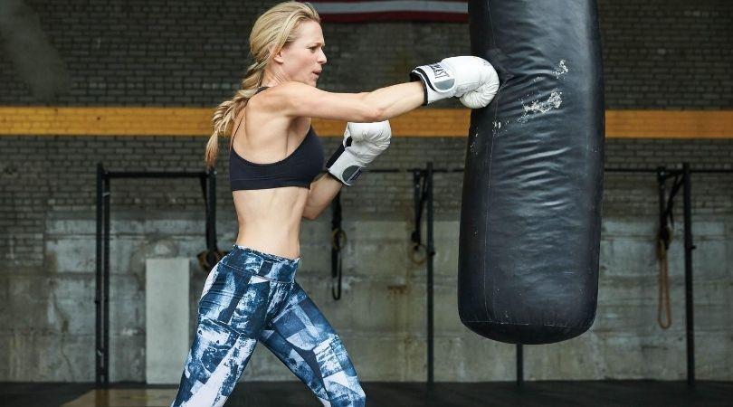 woman punching bag