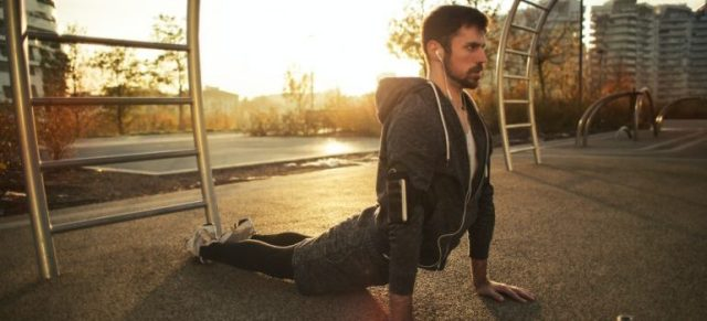 A man stretching.