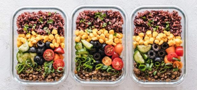 Healthy food in three containers.