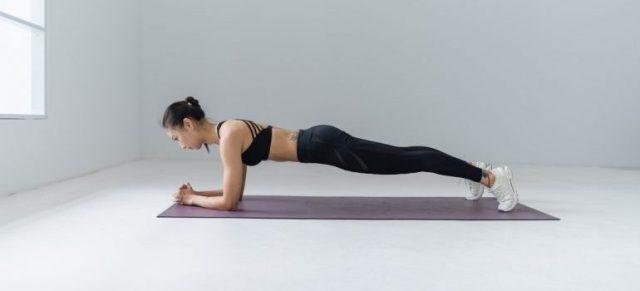 A girl doing a plank.