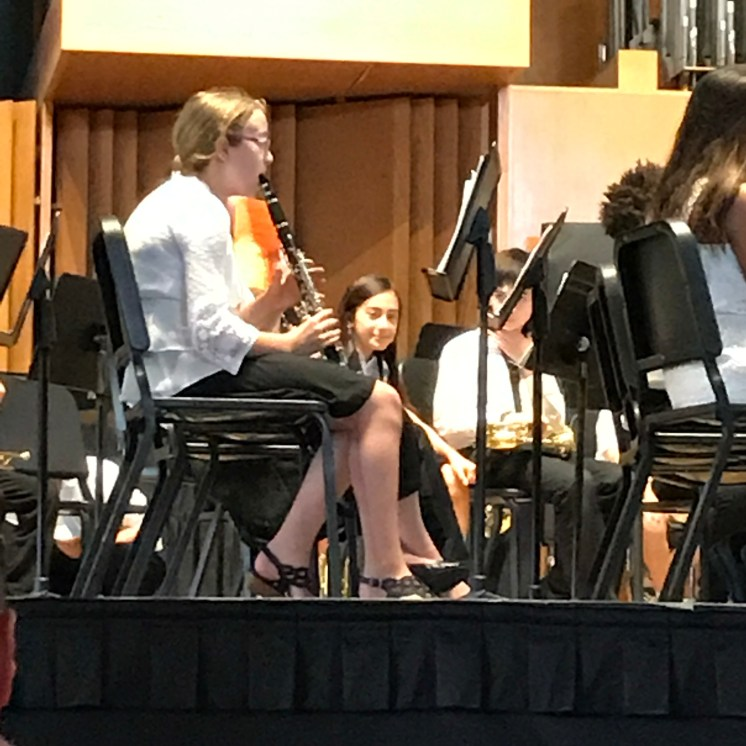 Maria peeks at me from the Honor Band stage at Syracuse University.