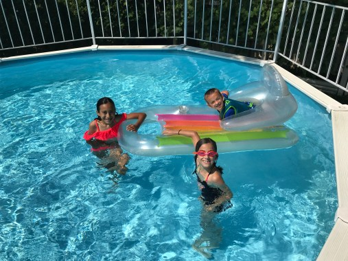 maria, lucia and christopher in the swimming pool