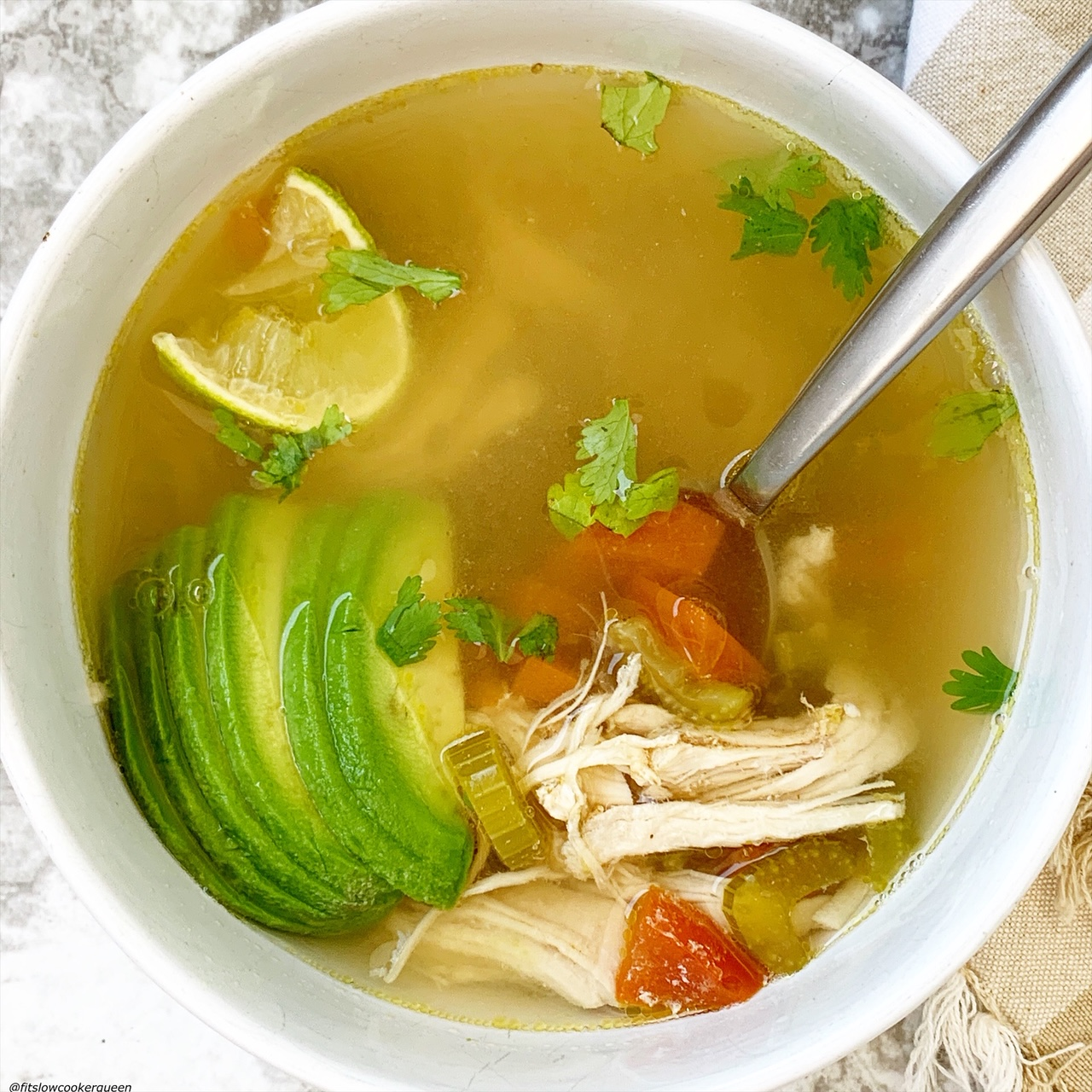 chicken avocado soup in a bowl