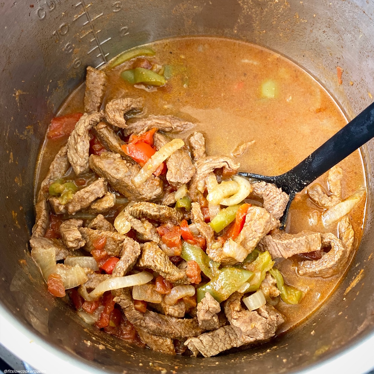 after pic of cooked steak fajitas in the pressure cooker