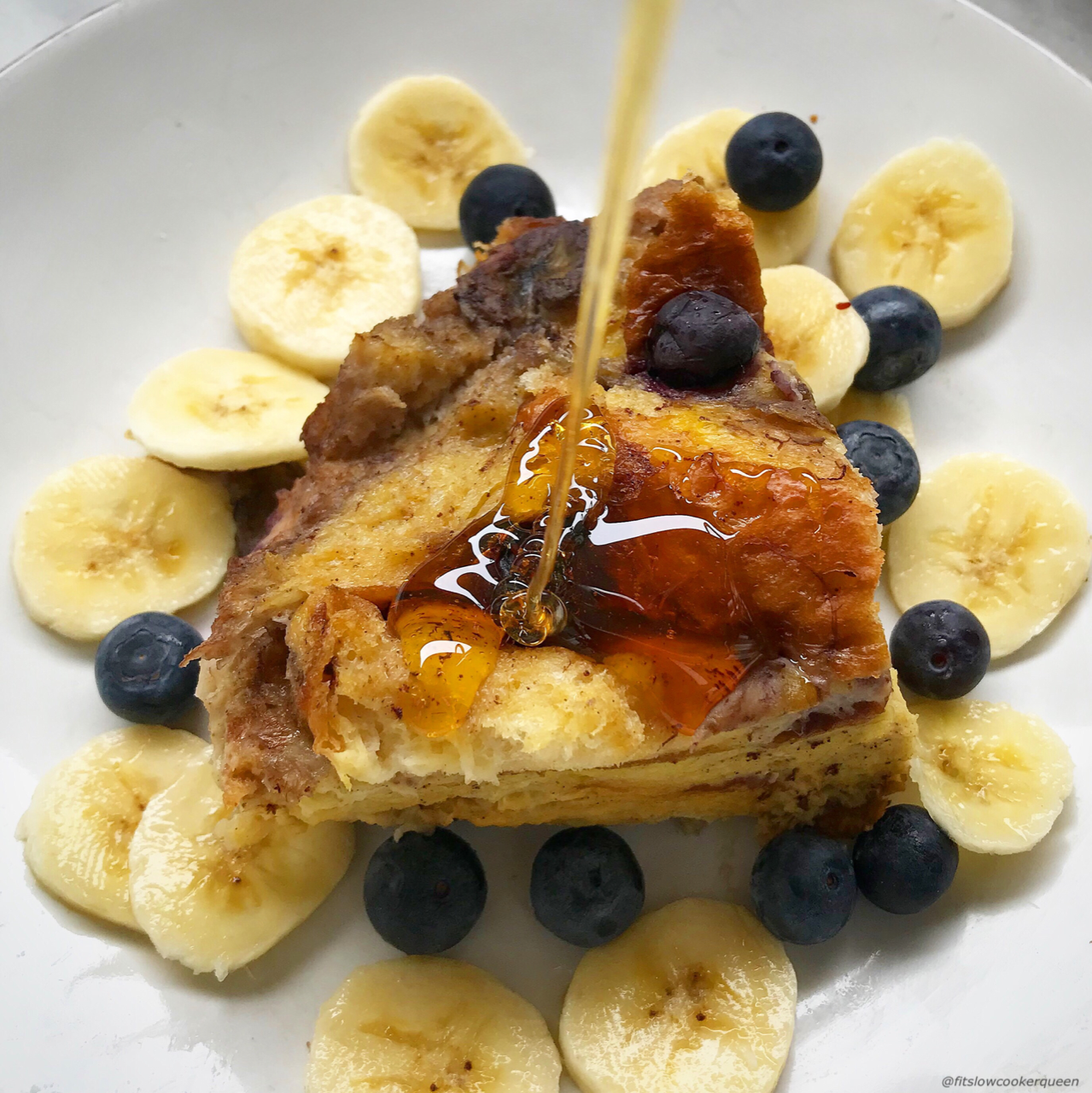 This French toast made with bananas and blueberries cooks overnight in the slow cooker. Wake up to an aromatic kitchen and fluffy French toast.