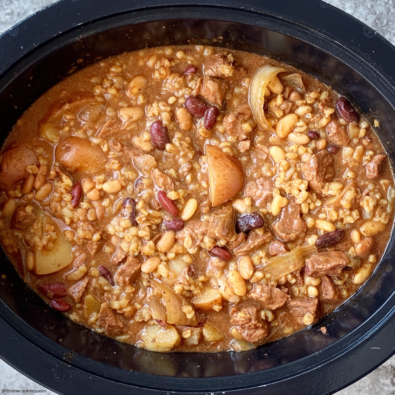 stirred cooked cholent in the slow cooker