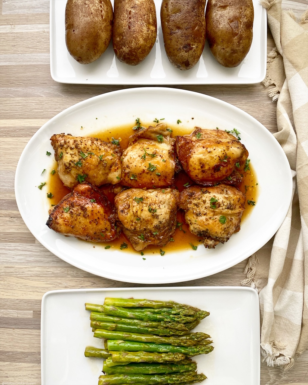 baked potatoes, asparagus, and chicken on white plate