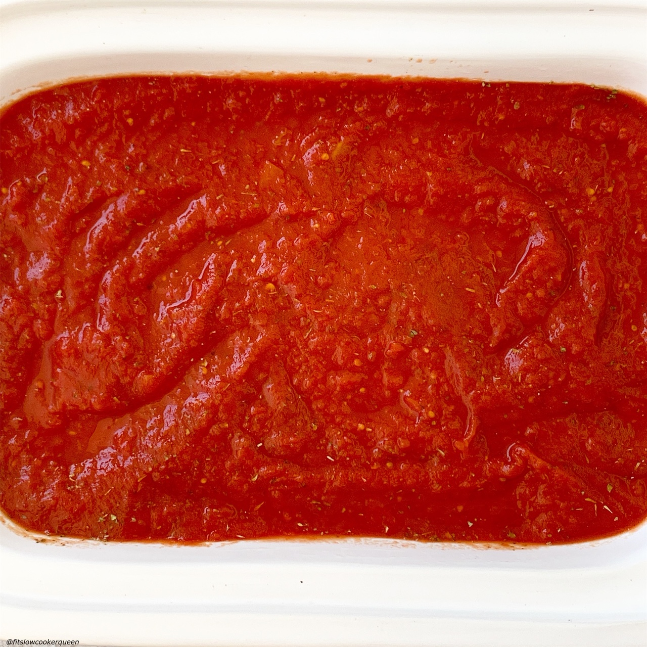sauce on top of the stuffed manicotti in the slow cooker for for slow cooker or instant pot stuffed manicotti