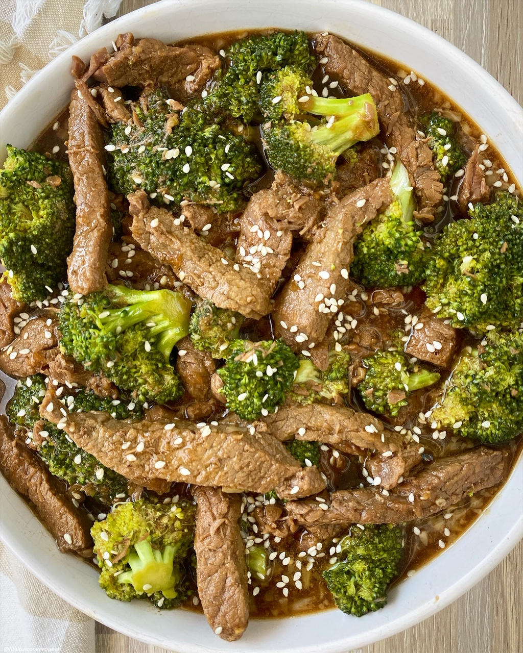 close up of cooked beef & broccoli in a bowl