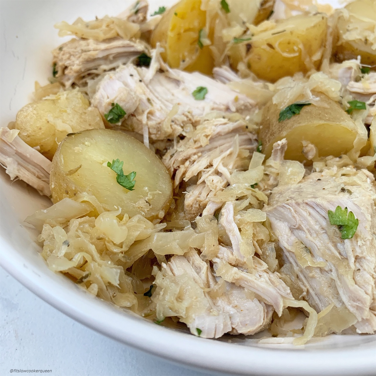 Pork & sauerkraut, an old country favorite that can be surprisingly healthy. This easy slow cooker or Instant Pot version is both whole30 and paleo.