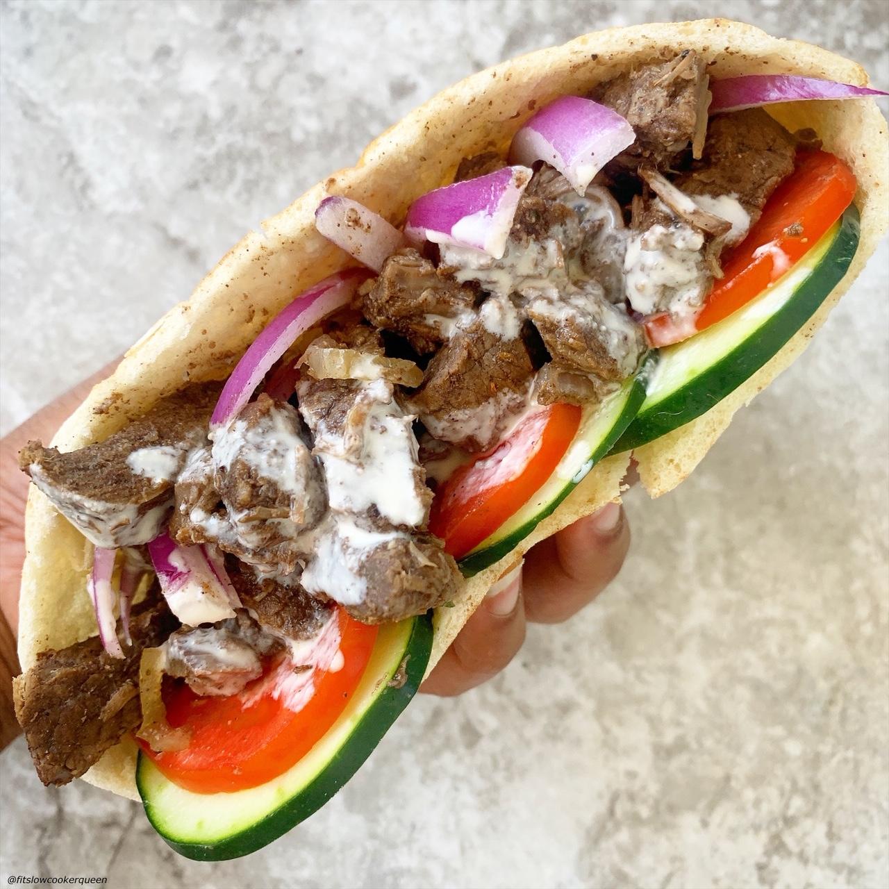 close up of beef shawarma in a pita