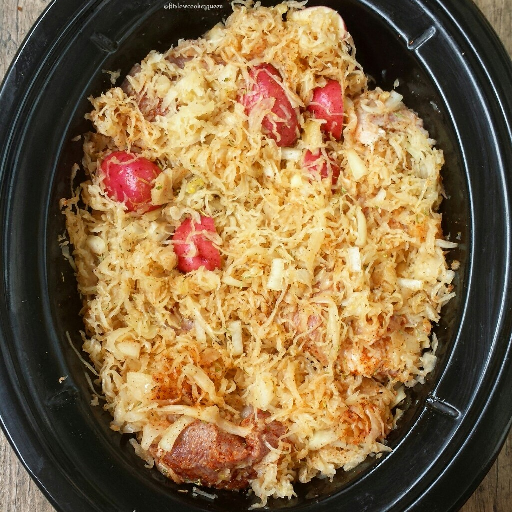 Pork & sauerkraut, an old country favorite that can be surprisingly healthy. This easy slow cooker version is both whole30 and paleo.