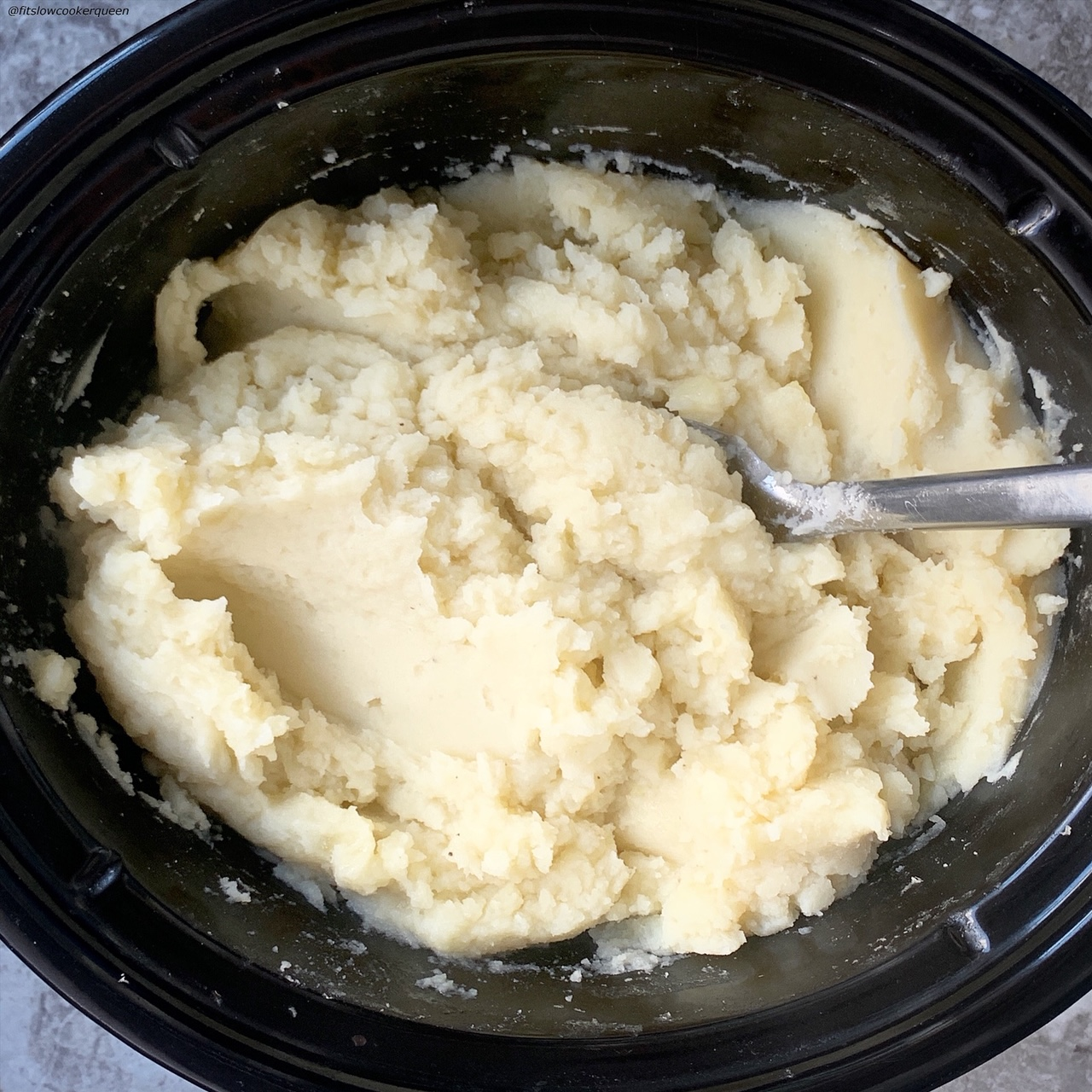 cooked potatoes in the slow cooker that have been mashed