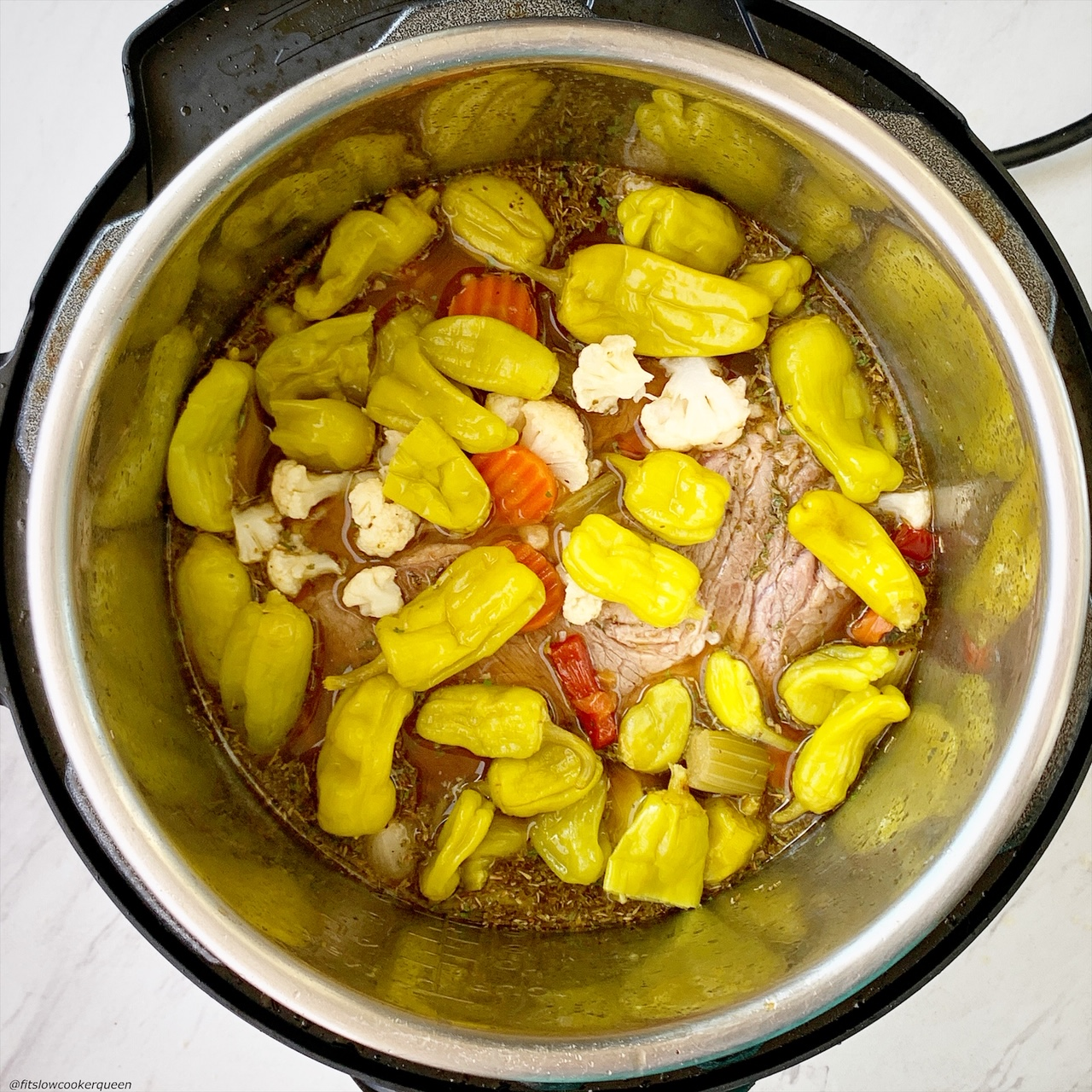 before pic of italian beef in the instant pot with pepperoncini pepperes & giardineria