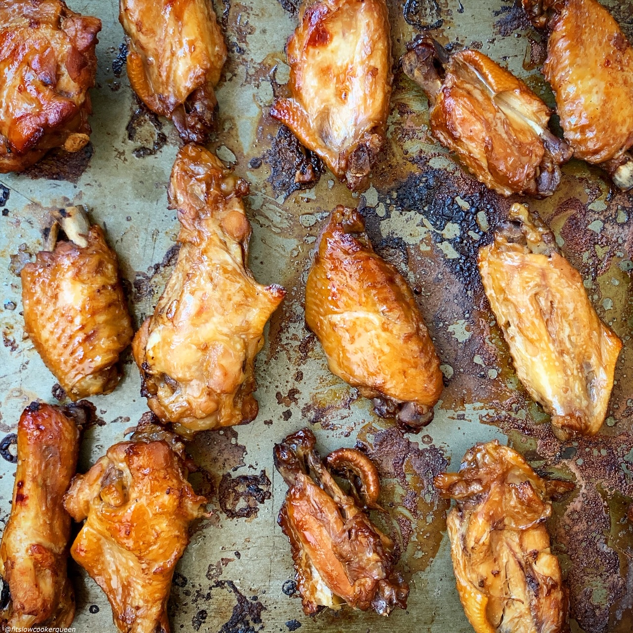 chicken wings on a baking sheet after being broiled