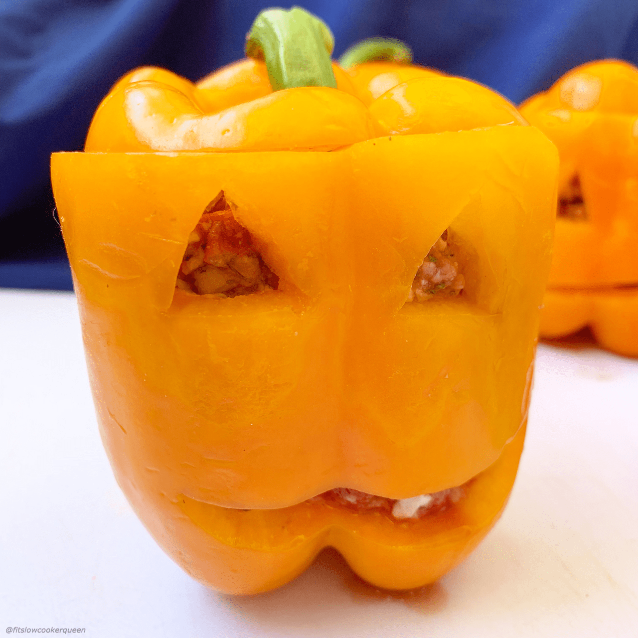 These jack-o-lantern stuffed peppers are a fun way to had some Halloween fun to your dinner table. The best part is they're low-carb, paleo, whole30, and made in the slow cooker for an super easy meal.