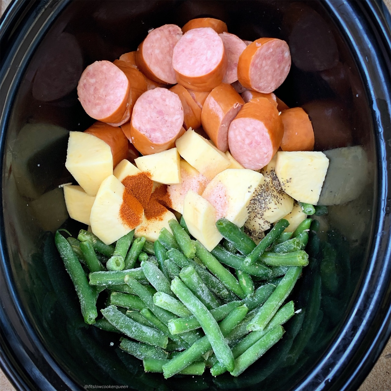 Sausage, potatoes, and green beans cook together in this simple slow cooker or Instant Pot staple recipe. Both paleo, and whole30, this healthy recipe can be served any time of the week.