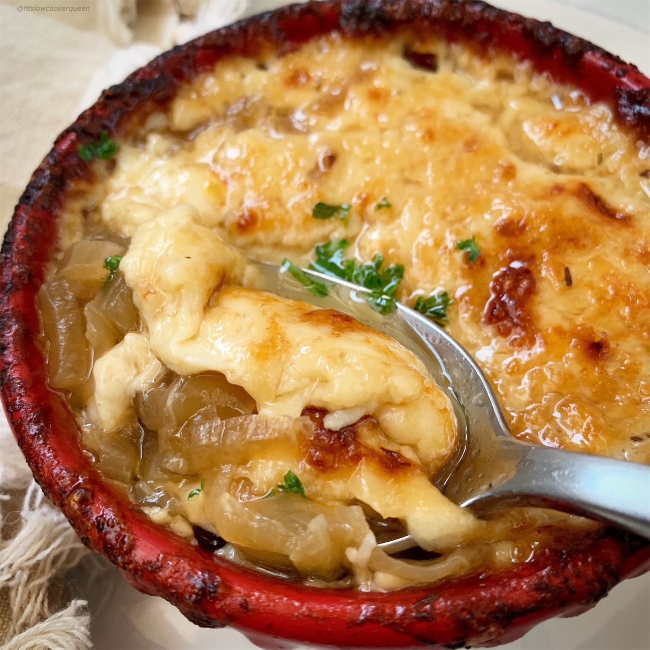 This low-carb version of French onion soup is cheesy and flavorful. Make this healthy yet comforting soup in your slow cooker or Instant Pot.