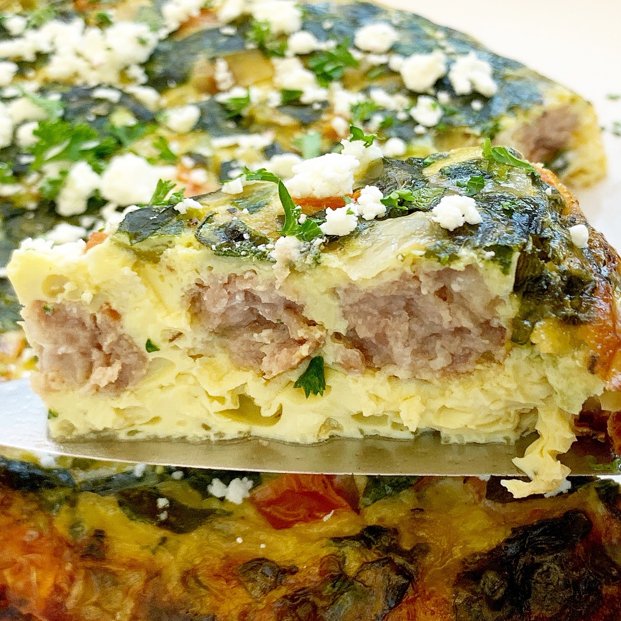 Breakfast sausage, spinach, and cheese cook together in this easy yet flavorful breakfast casserole. Make this healthy, low-carb breakfast in your slow cooker or Instant Pot.