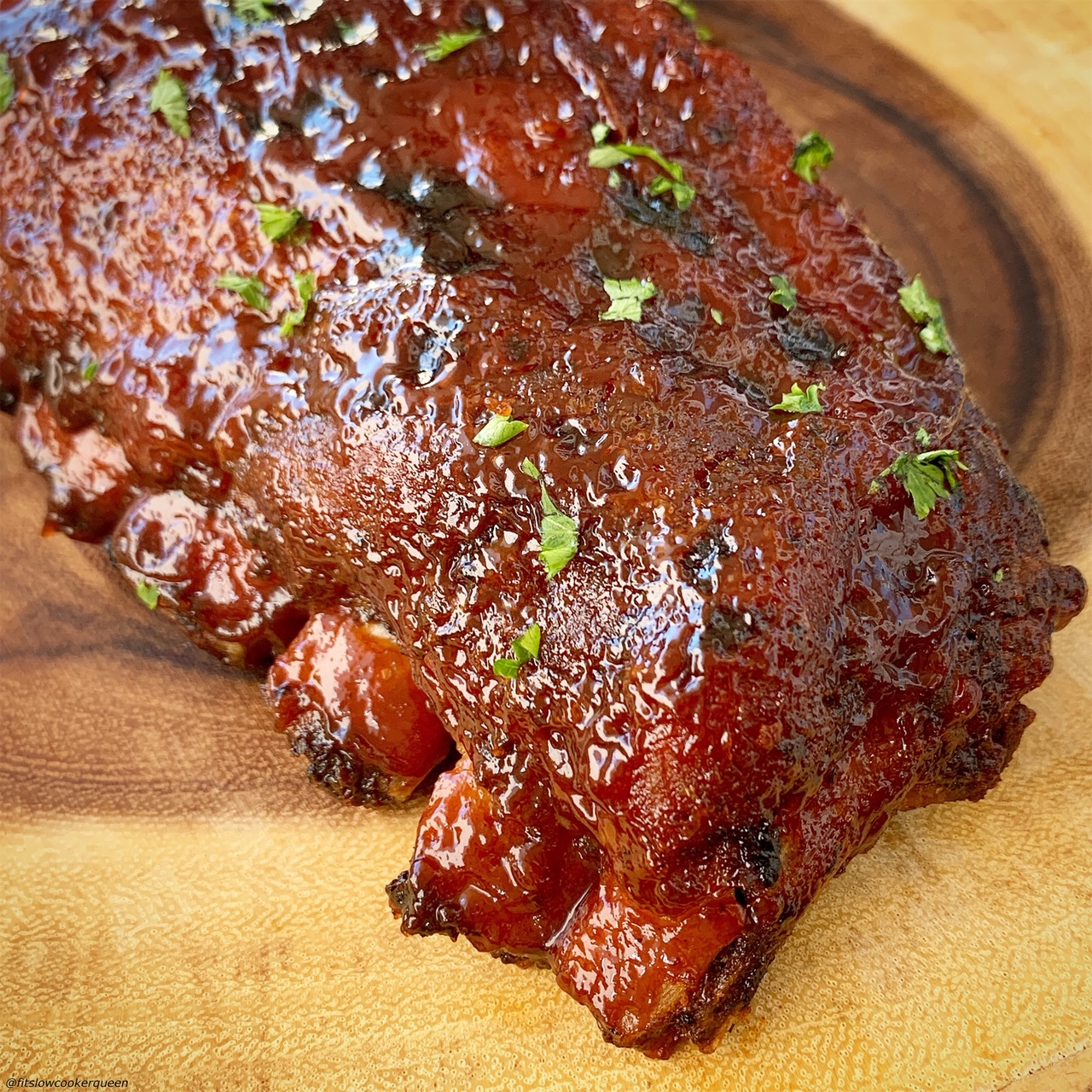 plated ribs before slicing for {VIDEO} Slow Cooker Instant Pot Ribs (Low-Carb, Paleo, Whole30)