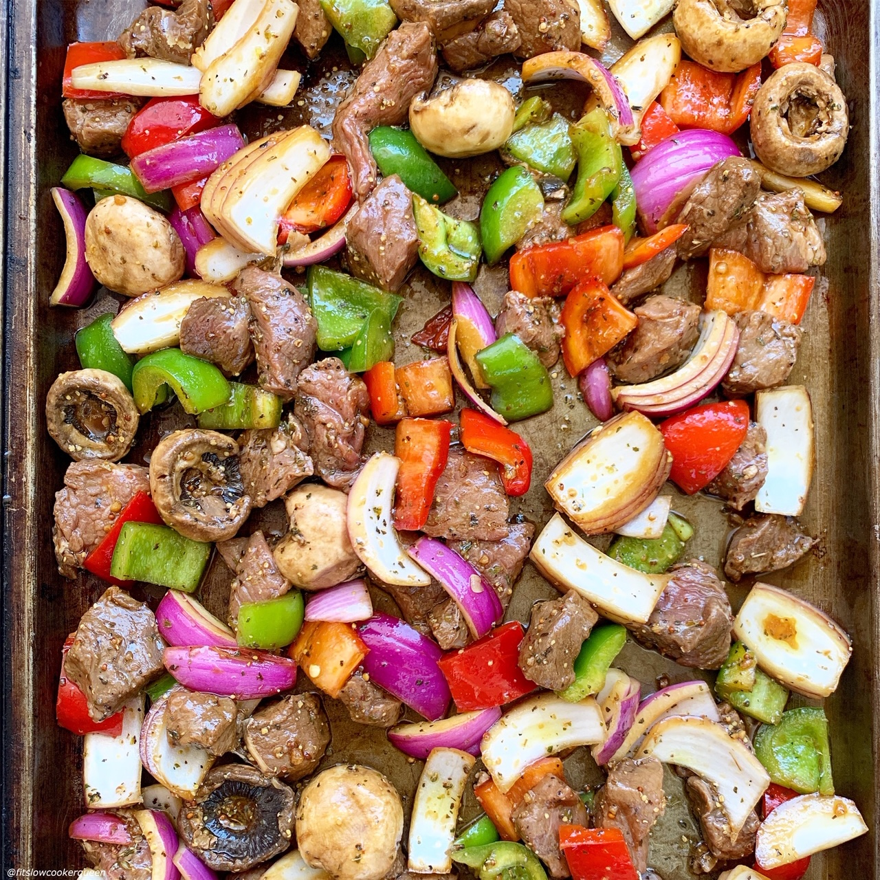 marinated meat and veggies on sheet pan