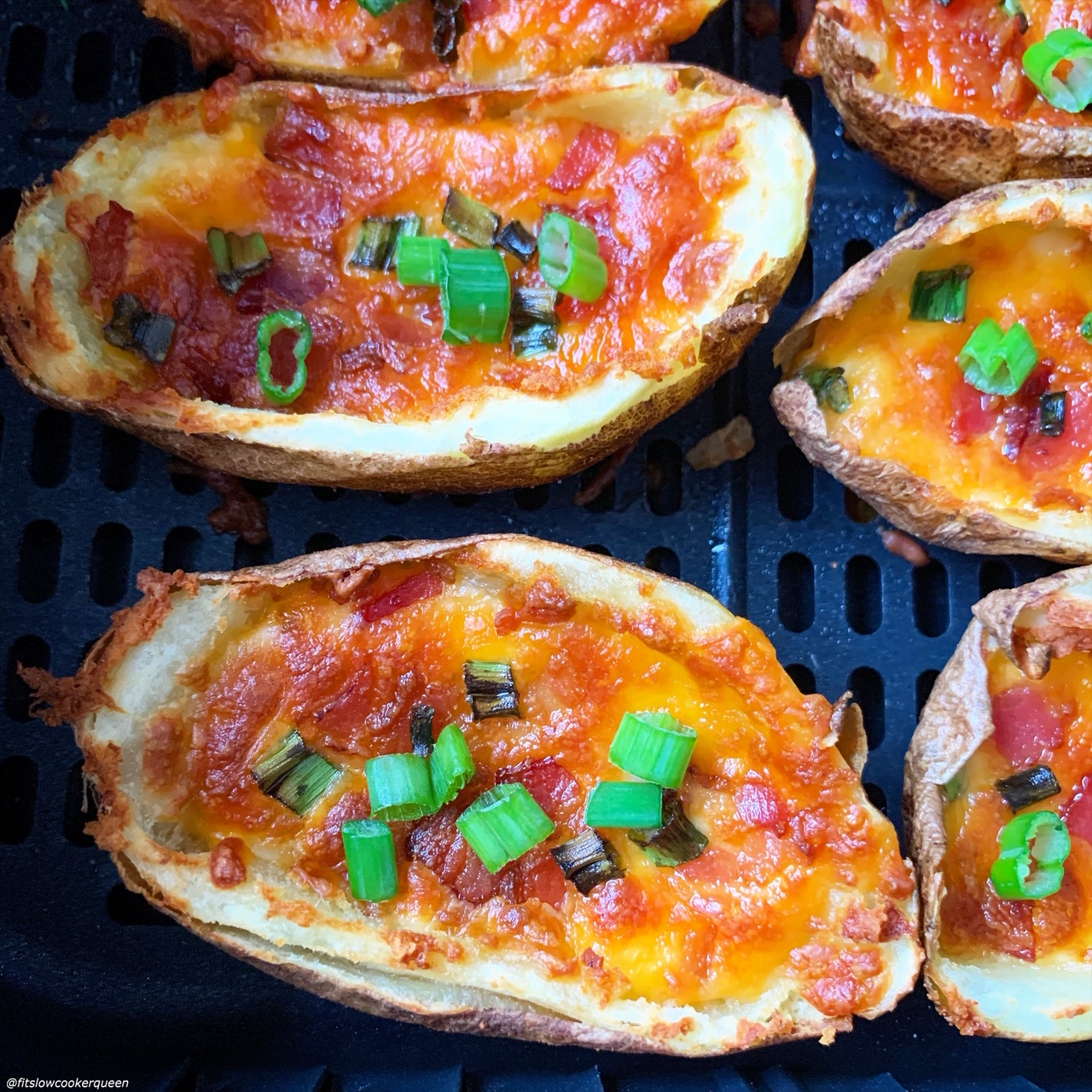 close up shot of cooked potato skins in the air fryer