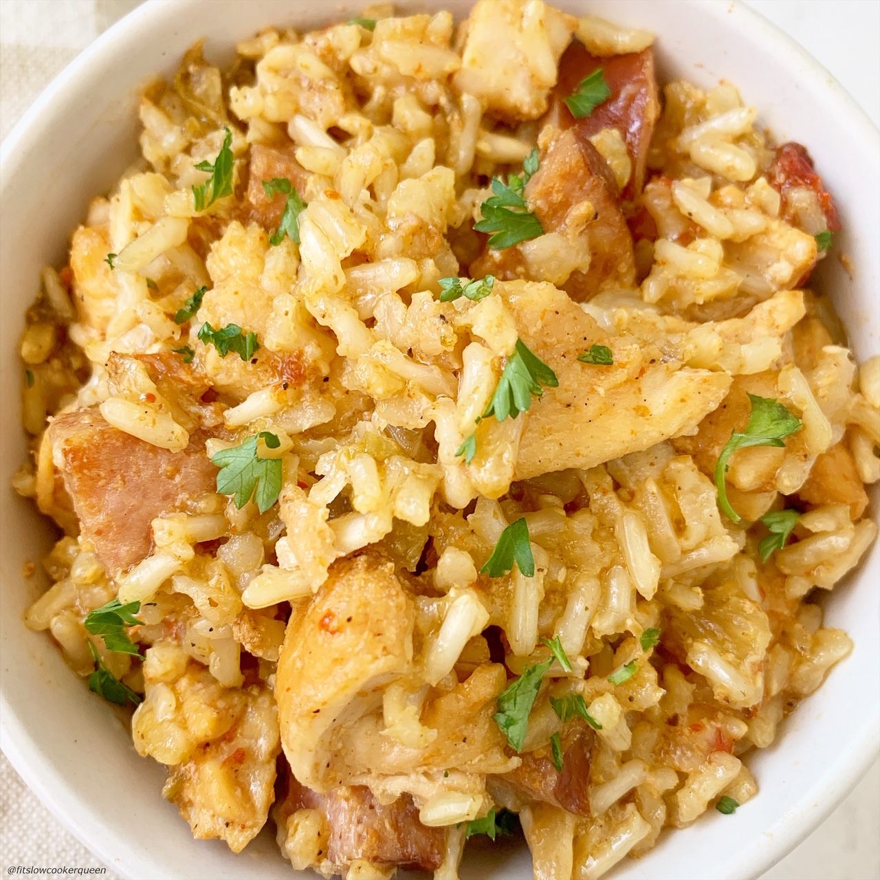 close up pic of creole rice w/chicken & sausage in a bowl