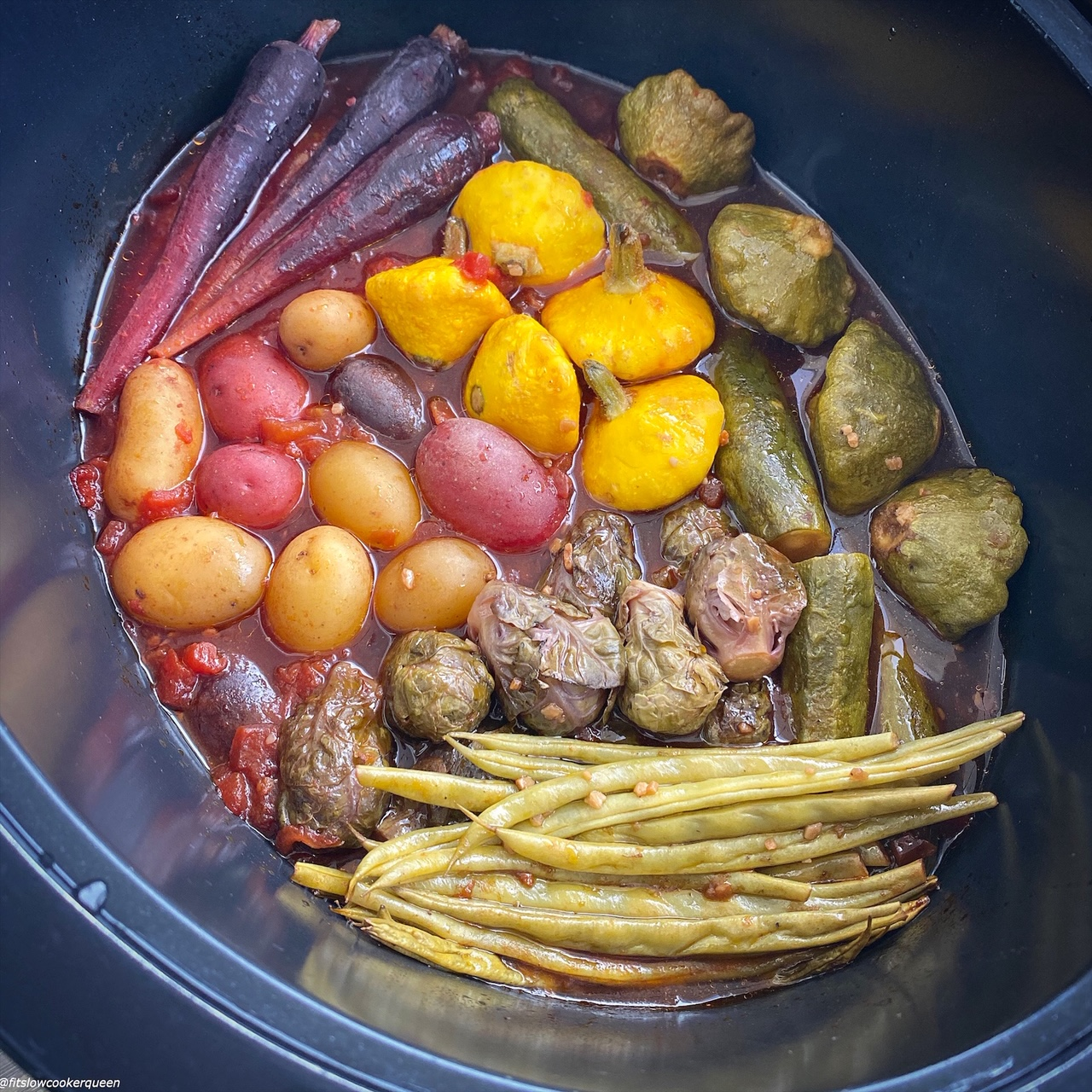 cooked vegetables in the slow cooker with sauce poured on top