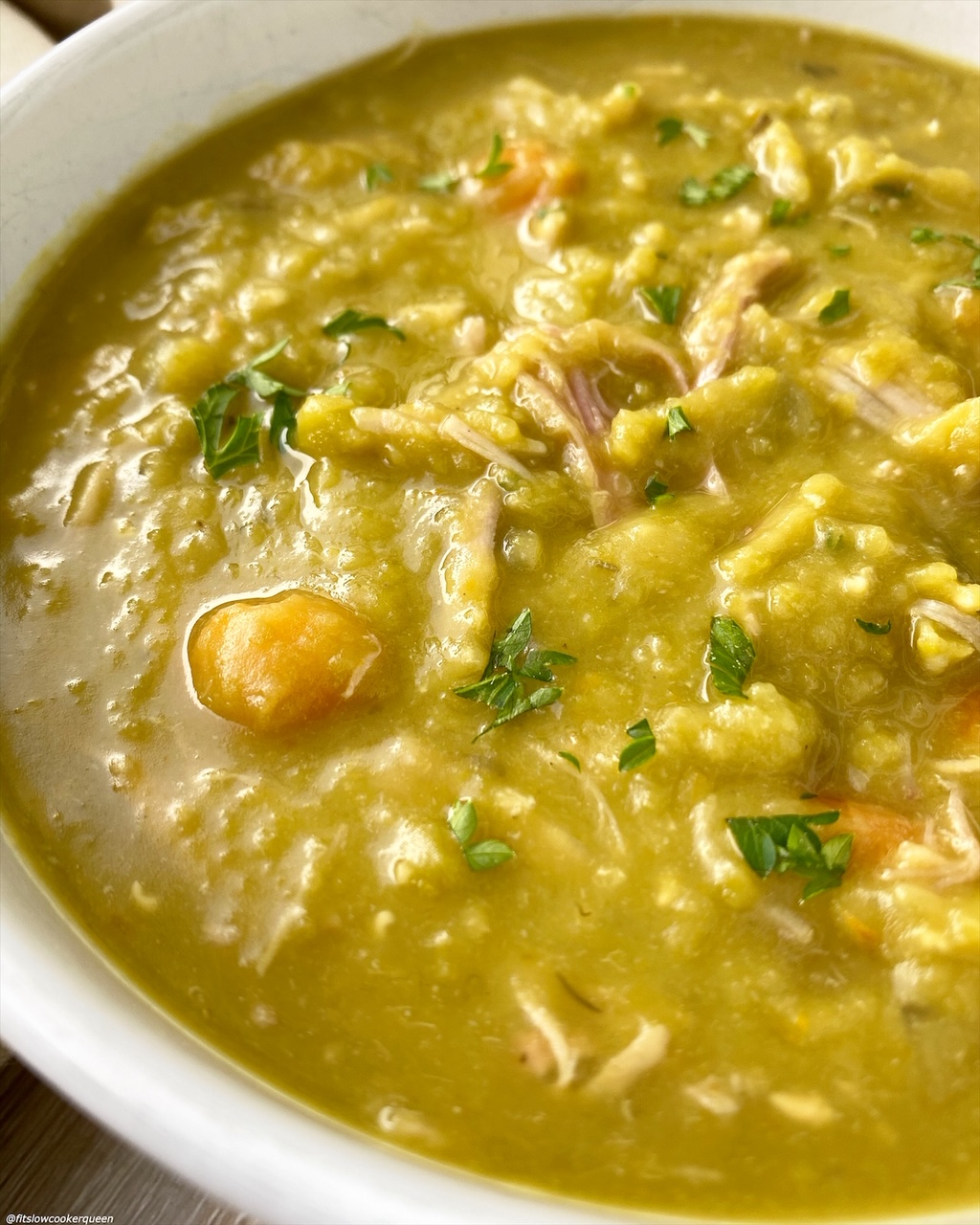 close up, side view of split pea soup in a bowl