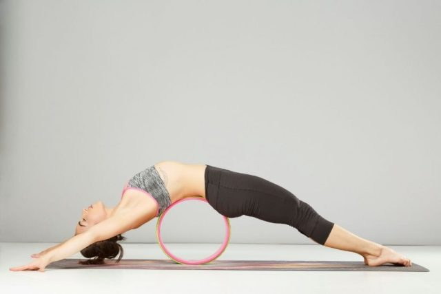 chakrasana modification on yoga wheel