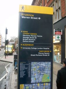 More street clutter. Well at least they screwed this sign into the right place. But the rather confusing maps (on the north side they are upside down) label the streets between Tottenham Court Road and Gower Street as Bloomsbury (when they are actually in Fitzrovia).