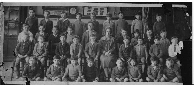 Group of children posing for school picture.