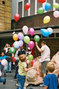 Balloons being let go in school playground.