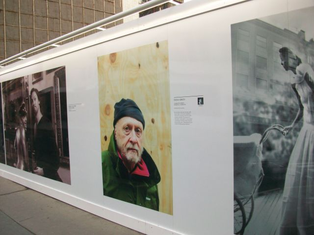 Photographs displayed on hoarding.