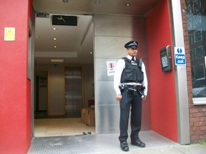 A police officer standing outside building.