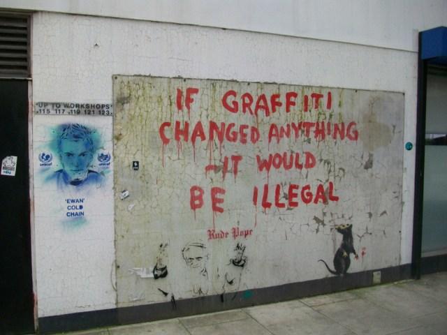 Banksy artwork on wall saying: If Graffiti Changed Anything.