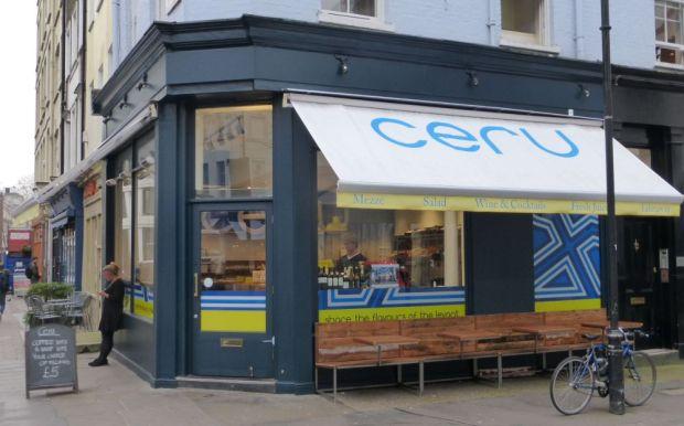Front of restaurant on corner of street.