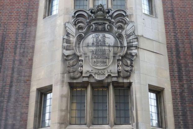 Inscription on stone facade.