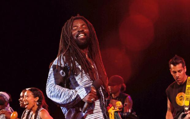 Reggae musician on stage.