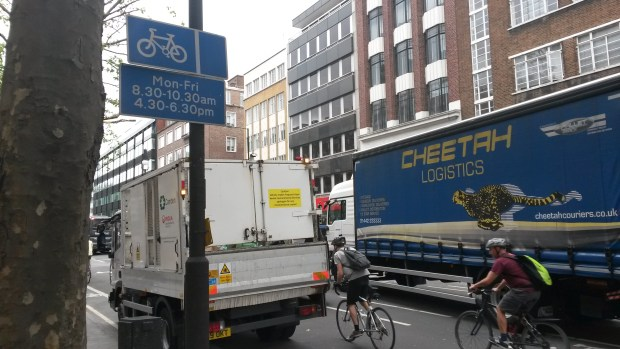 Truck parked in cycle lane on Tottenham Court Road.
