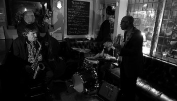 Musicians playing inside a pub.