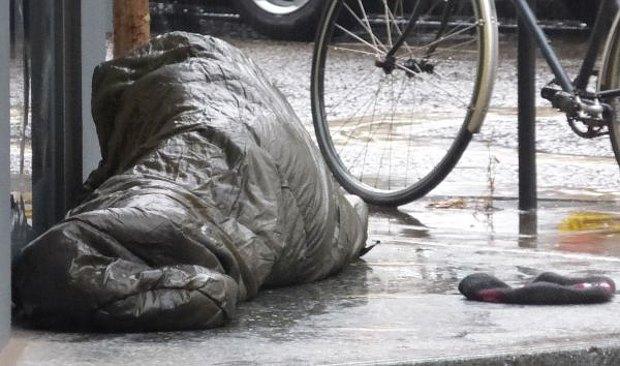 Rough sleeper in rain.