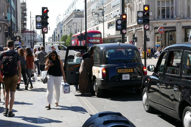Buses and taxis on Oxford Street.