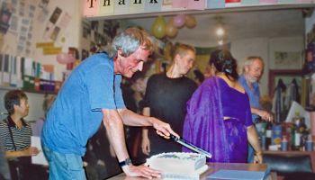 Dave Ferris cutting cake.